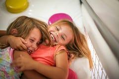 Duas meninas no campo de jogos Imagens de Stock Royalty Free