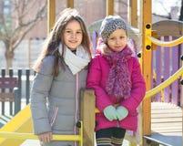 Duas meninas no campo de jogos urbano Imagem de Stock Royalty Free