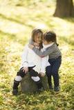 Duas meninas no parque do outono Fotos de Stock Royalty Free