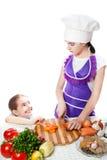Duas meninas preparam o alimento Imagens de Stock Royalty Free
