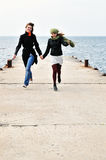 Duas meninas running felizes Imagens de Stock Royalty Free