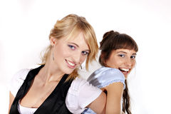 Duas meninas 'sexy' e sorrindo bonitas Imagem de Stock