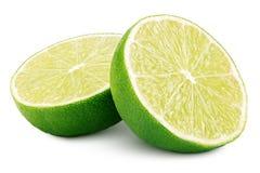 Duas metades de citrinos verdes do cal no branco Imagem de Stock Royalty Free