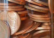 Duas moedas do centavo em uma garrafa Imagem de Stock Royalty Free