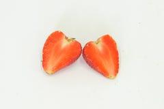 Duas morangos das partes Fotografia de Stock Royalty Free