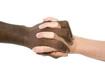 Duas mãos que simbolizam a diversidade do mundo Fotos de Stock Royalty Free