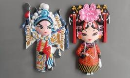 Duas mulheres chinesas animados em seu traje nacional Imagens de Stock Royalty Free