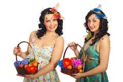 Duas mulheres da mola com flores Imagem de Stock Royalty Free