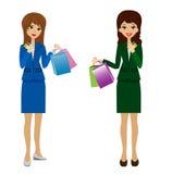 Duas mulheres de negócio com cartões de crédito e compras nas mãos ilustração stock