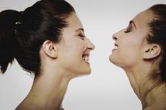 Duas mulheres de riso com compõem Fotos de Stock Royalty Free