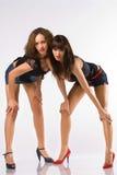 Duas mulheres dobraram-se para baixo Fotografia de Stock Royalty Free