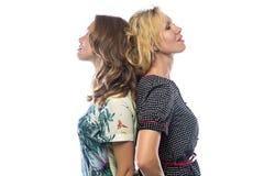 Duas mulheres eretas no fundo branco Fotos de Stock Royalty Free