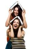 Duas mulheres felizes com livros junto Fotografia de Stock Royalty Free