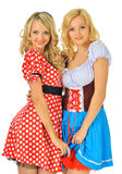 Duas mulheres louras bonitas em trajes do carnaval imagens de stock