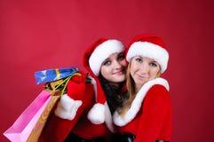 Duas mulheres no vestido como Santa Fotografia de Stock