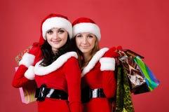 Duas mulheres no vestido como Santa Imagens de Stock Royalty Free