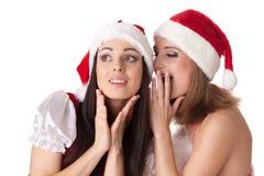 Duas mulheres novas no traje de Santa. Imagens de Stock Royalty Free