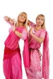 Duas mulheres que dançam a dança de barriga Imagem de Stock