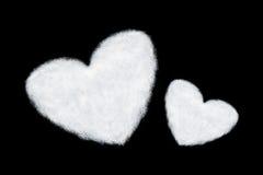 duas nuvens dadas forma coração isoladas no preto Imagem de Stock