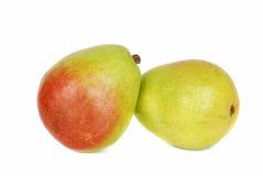 Duas peras verdes sobre o fundo branco. foto de stock royalty free