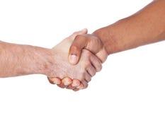 Duas pessoas das culturas diferentes que agitam as mãos Imagem de Stock Royalty Free