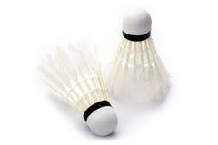 Duas petecas do badminton no fundo branco Imagens de Stock Royalty Free