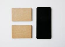 Duas pilhas de cartões e de smartphone do ofício no fundo branco horizontal fotografia de stock royalty free
