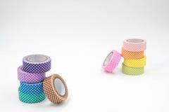 Duas pilhas de fita colorida de Washi no fundo branco Fotos de Stock