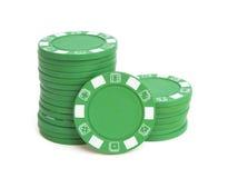 Duas pilhas de microplaquetas de pôquer verdes Fotos de Stock