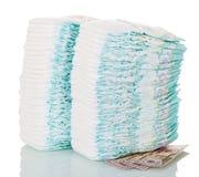 Duas pilhas de tecidos descartáveis e de dinheiro isolados no branco Imagens de Stock Royalty Free