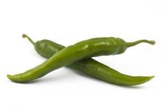 Duas pimentas de pimentão verdes no branco imagens de stock