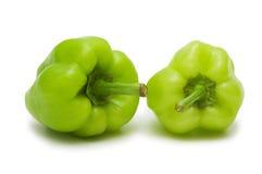 Duas pimentas de sino verdes fotografia de stock