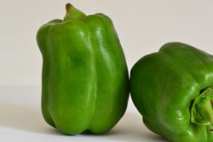 Duas pimentas verdes Imagem de Stock