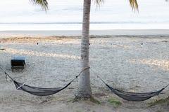 Duas redes que penduram na praia foto de stock royalty free