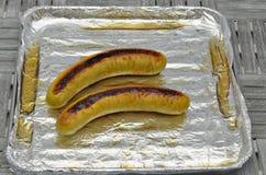 Duas salsichas grelhadas Foto de Stock Royalty Free