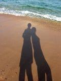 Duas sombras e ondas Fotografia de Stock