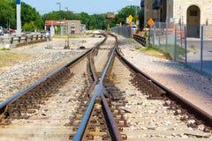 Duas trilhas de estrada de ferro em uma que cria um X Fotografia de Stock Royalty Free