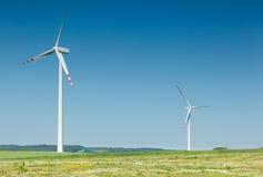 Duas turbinas de vento Imagem de Stock Royalty Free