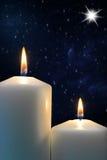Duas velas com a estrela de Bethlehem Fotografia de Stock