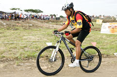 Duathlon biker. Picture of a duathlon biker/athlete in a race Stock Image