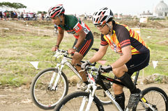 Duathlon bikers. Picture of two duathlon bikers racing against each other Royalty Free Stock Photos
