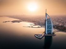 Dubai aerial seaside skyline with luxury hotel view at sunrise. Dubai seaside skyline with luxury hotel aerial view at sunrise, burj, arab, jumeirah, above royalty free stock photography
