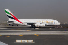DUBAI - 1 APRIL 2015: An Emirates Airbus A380 Superjumbo in Dubai. The Airbus A380 is the world's largest passenger airliner.. Emirates is an airline based in Stock Image