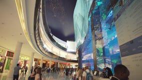 Dubai Aquarium and Under Water Zoo in the shopping mall`s interior Dubai Mall. People enjoying the beautiful view stock. Dubai, UAE - April 09, 2018: Dubai stock video footage