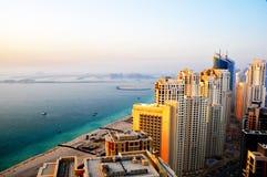 Dubai Beach Living 2. A cluster of luxury apartments in Dubai Marina overlooking the famous Palm Jumeirah island royalty free stock photo