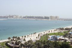 Dubai Beach and Palm Construction. Elevated view of a beach on the coast of Dubai with the construction for The Palm showing in the horizon Stock Photo