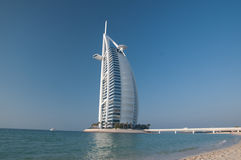 Dubai beach,UAE. View of the luxury beach of Dubai with the Burj al arab the most exclusive hotel of the world, and one of the few seven star. Here against a Stock Images