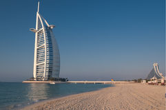 Dubai beach,UAE. View of the luxury beach of Dubai with the Burj al arab the most exclusive hotel of the world, and one of the few seven star. Here against a Stock Image