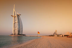 Dubai beach,UAE. View of the luxury beach of Dubai at sunset witha gently warm light, with the Burj al arab the most exclusive hotel of the world, and one of the Stock Photography