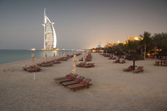 Dubai beach,UAE. View of the luxury beach of Dubai at dusk with a gently warm light, with the Burj al arab the most exclusive hotel of the world, and one of the Stock Photo